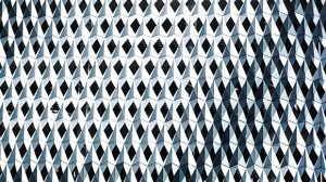 Blue and white abstract wall with geometrical shapes