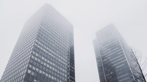 high rise building in clouds