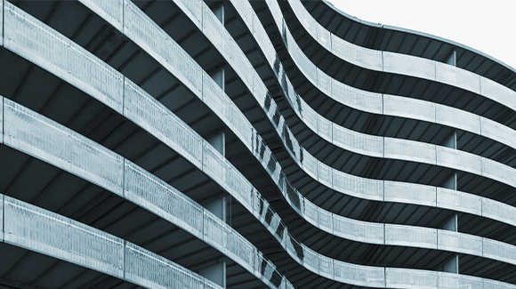 Blue toned curved modern building surface.