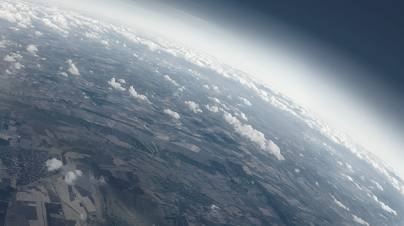 Cloudy sky in space looking at Earth.